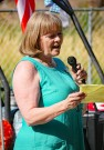 Annual Democratic picnic on Sunday held at Rock Creek Park-2018. Deb Silver reads her notes to speak on key points.