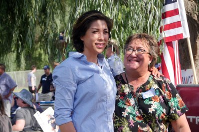 Annual Democratic picnic on Sunday held at Rock Creek Park-2018. Chris Chugg takes a picture with Paulette Jordan.